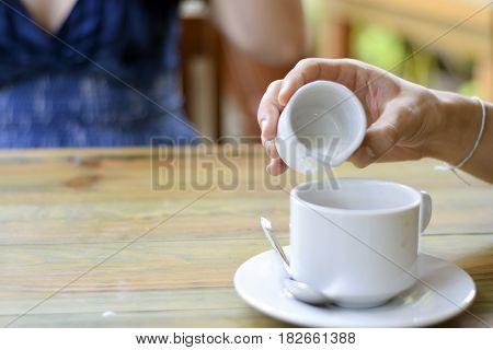 Male Hand Pouring Cream