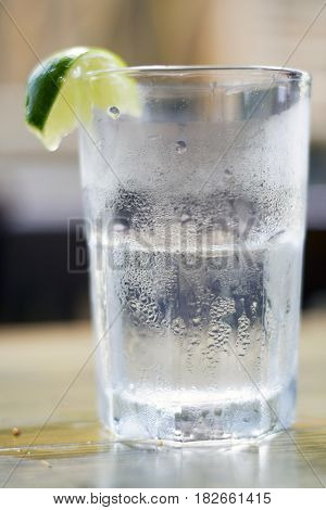 Glass Of Water With Condensation And Lime Wedge