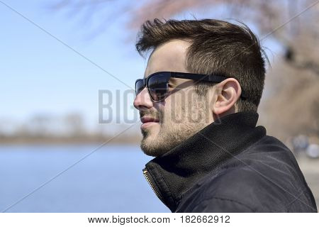 Man On A Walk Looking Out At Water