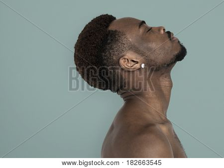 African Man Bare Chest Chin Up Side View Portrait