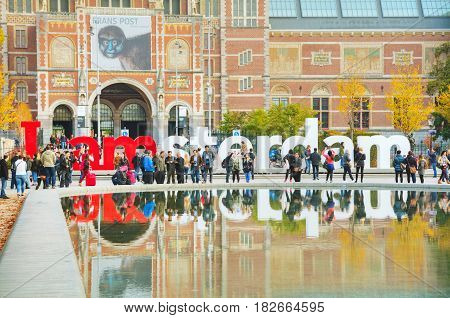 AMSTERDAM - OCTOBER 30: I Amsterdam slogan on October 30 2016 in Amsterdam Netherlands. Located at the back of the Rijksmuseum on Museumplein the slogan quickly became a city icon.