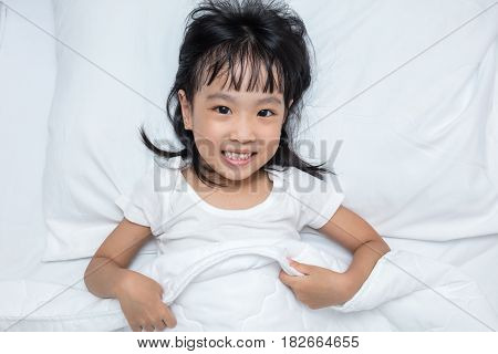 Asian Little Chinese Girl Lying On The Bed