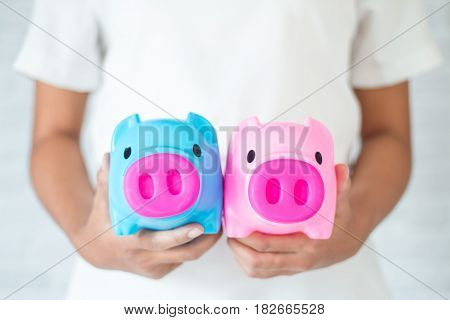 Saving money for the future in a piggy bank