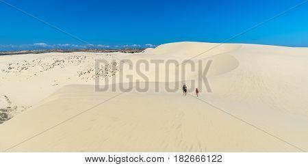 Mui Ne, Vietnam - February 18th, 2017: Visitors are experiencing the high white sand hill in Mui Ne, Vietnam.