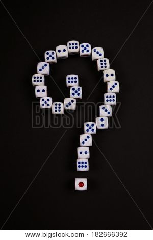 question mark symbol from dice array on black background