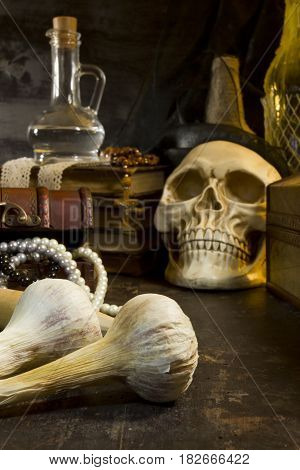 Gothic still life with skull and garlic