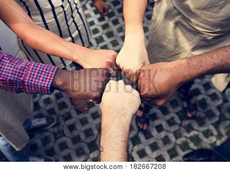 Diversity hands fist bump for support and team-building