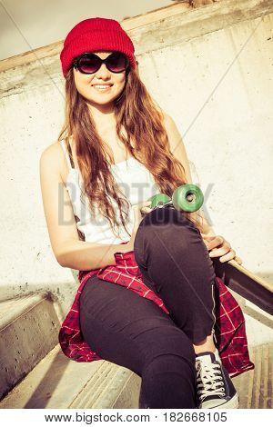 Pretty smiling teen skater girl