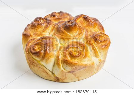 Beautiful homemade fresh bun close-up on white background