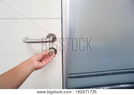 close up businesswoman lock office door with left hand