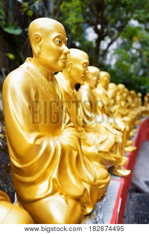 Golden Buddha Statues Along The Stairs Leading To The Ten Thousand Buddhas Monastery On Nature Backg