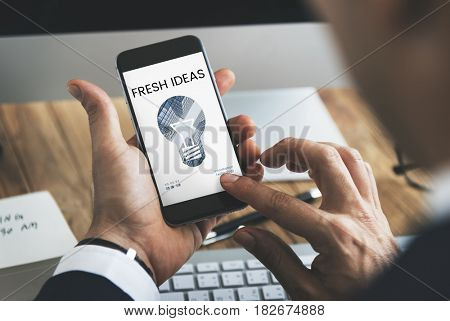 Graphic of creative ideas digital technology light bulb on mobile phone