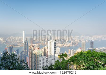 View Of Hong Kong City And Victoria Harbor From The Victoria Peak On A Sunny Day