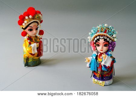 Traditional married Chinese dolls isolate on gray background