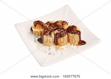 Dessert rolls on the plate isolated on white
