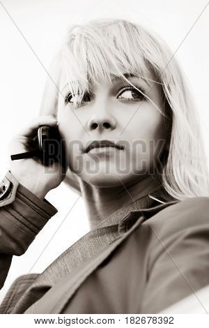 Young blond fashion woman calling on mobile phone outdoor