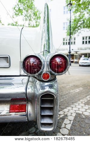BERLIN - JUNE 05 2016: The rear brake lights of full-size luxury car Cadillac Fleetwood Series 70 Eldorado Brougham 1957. Classic Days Berlin 2016.
