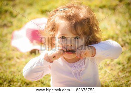 Portrait of baby girl in park