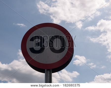 A Road Traffic Sign With A Sky Background Saying 30 Speed Limit Near School Accident Crash Cars Fast