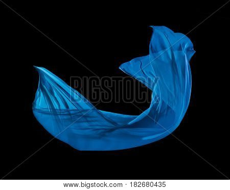Smooth elegant blue cloth separated on black background. Texture of flying fabric.