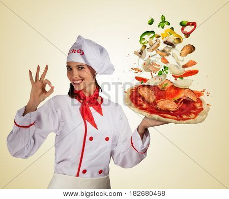 Young woman chef. Concept of flying ingredients with pizza dough, isolated on bright background. Food preparation, fresh meal ready for cooking