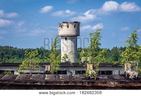 Building roof and water tower in Skrunda Soviet military ghost town in Lativa