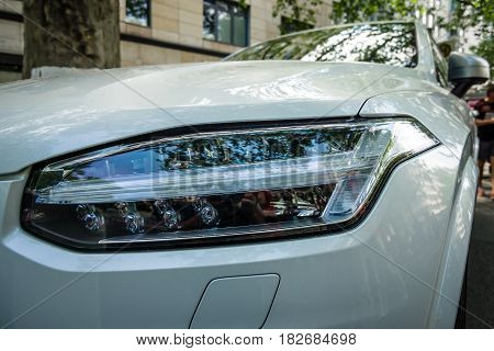 BERLIN - JUNE 05 2016: Headlamp of mid-size luxury crossover SUV Volvo XC90. Classic Days Berlin 2016.