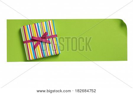 Striped gift box with bow on the green paper letter blank isolated on white background