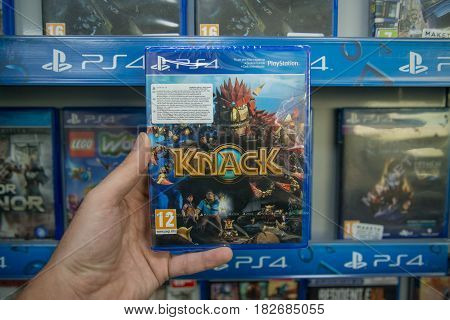 Bratislava, Slovakia, circa april 2017: Man holding Knack videogame on Sony Playstation 4 console in store