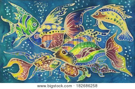 beautiful colorful watercolor hand painted batik fish on blue textile background