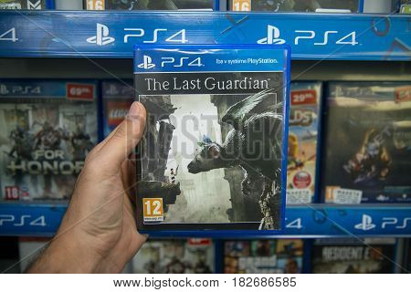 Bratislava, Slovakia, circa april 2017: Man holding The Last Guardian videogame on Sony Playstation 4 console in store