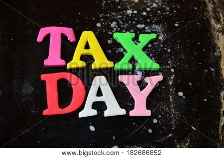 word tax day on a  abstract colorful background