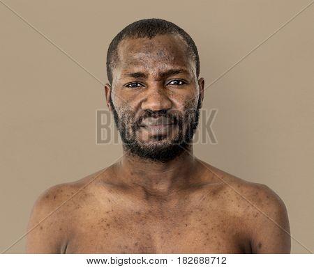 African man mustache bare chest studio portrait