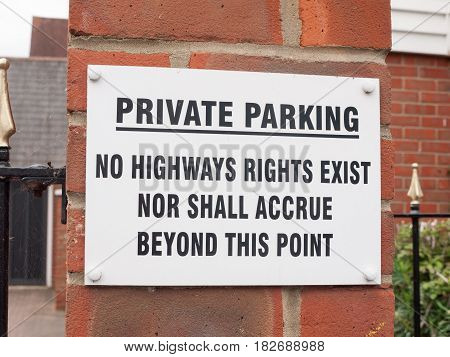 A Sign Outside Near A Private Residential Old People Car Park Saying Private Parking No Highways Rig
