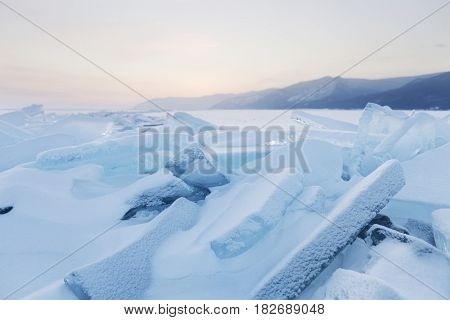 Turquoise Ice Floes. Winter Sunset Landscape.