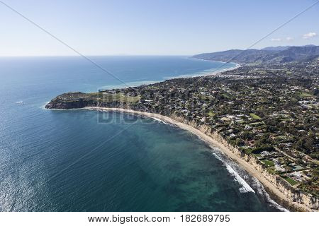 Aerial view of ocean view homes and Point Dume State Park in Malibu, California.