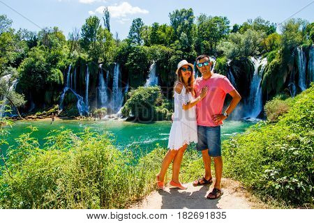 Lovely Couple in Glasses near Kravice Waterfall Bosnia and Herzegovina
