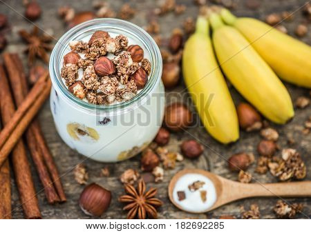 Serving of Yogurt with Muesli Banana and Nuts