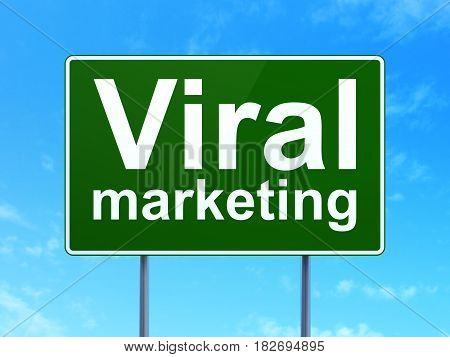 Marketing concept: Viral Marketing on green road highway sign, clear blue sky background, 3D rendering