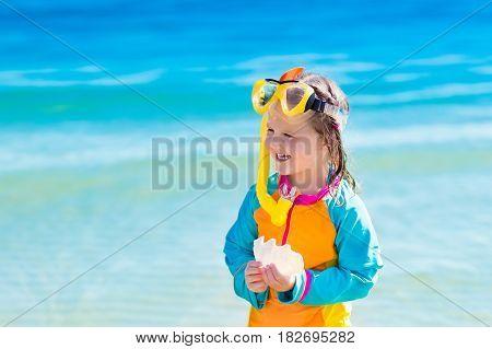 Child Snorkeling On Tropical Beach