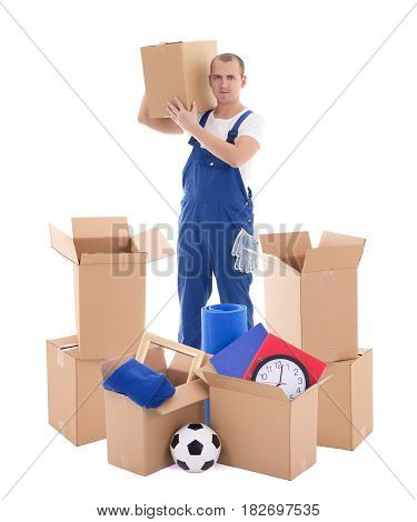 Moving Day Concept - Young Handsome Man In Blue Workwear With Cardboard Boxes Isolated On White