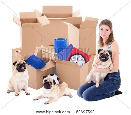 Young Woman With Brown Cardboard Boxes And Pug Dogs Isolated On White
