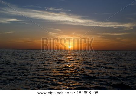 Photo of picturesque sunset by sea shore