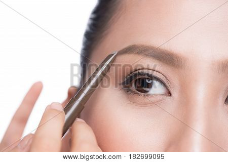 Closeup Of Beautiful Glamourous Asian Woman With Professional Makeup Contouring Brows With Eyebrow P