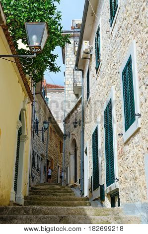 HERCEG NOVI MONTENEGRO - SEPTEMBER 25 2015: Unknown tourists are photographed on narrow street in Herceg Novi Montenegro