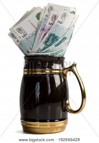 Banknotes in the mug. The concept of capital accumulation