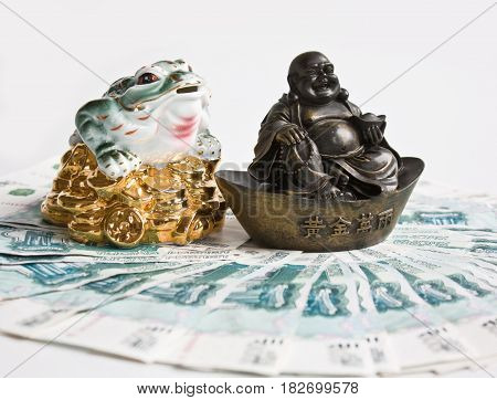 Chinese Feng Shui Budai or Pu-Tai and the money toad is sitting on the banknote poster