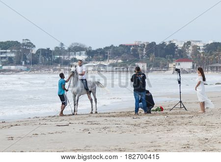 Photographer Photographs As Instructor Trains Man To Ride A Horse