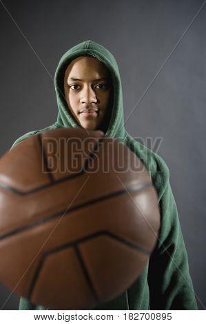 Mixed race boy holding basketball