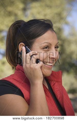Hispanic woman talking on cell phone